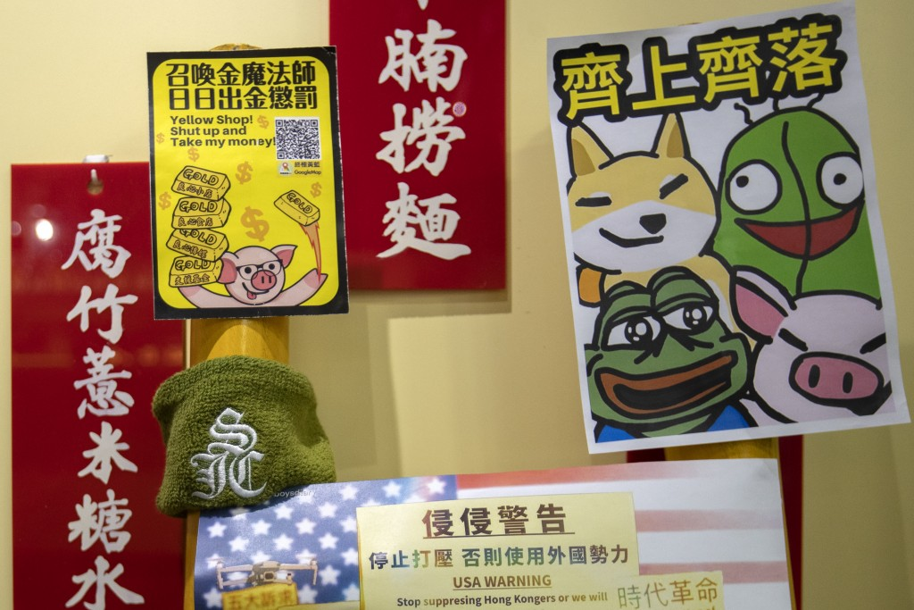 "In this Dec. 13, 2019, photo, posters line the walls of a pro-protest ""yellow"" noodle shop in Hong Kong. Protesters in Hong Kong are increasingly usin..."