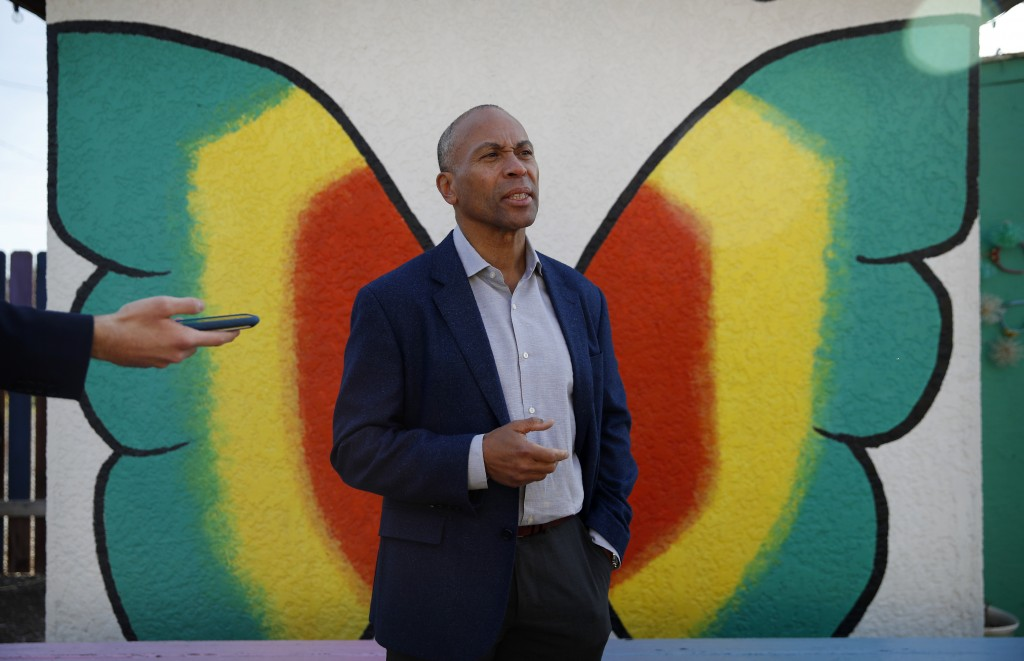 Democratic presidential candidate former Massachusetts Gov. Deval Patrick speaks with the media after touring a community garden Tuesday, Dec. 17, 201...