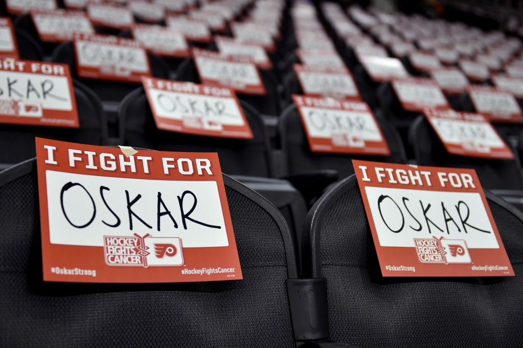 Signs are displayed in support for Philadelphia Flyers' Oskar Lindblom prior to an NHL hockey game against the Anaheim Ducks, Tuesday, Dec. 17, 2019, ...