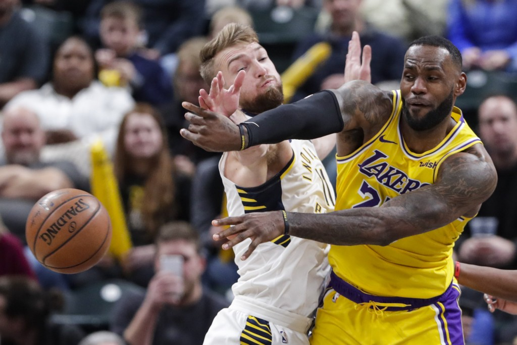 Los Angeles Lakers forward LeBron James (23) makes a pass in front of Indiana Pacers forward Domantas Sabonis (11) during the second half of an NBA ba...