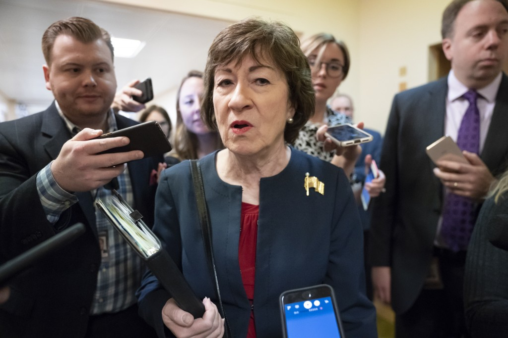FILE - In this Nov. 6, 2019, file photo, Sen. Susan Collins, R-Maine, is surrounded by reporters as she heads to vote at the Capitol in Washington. U....