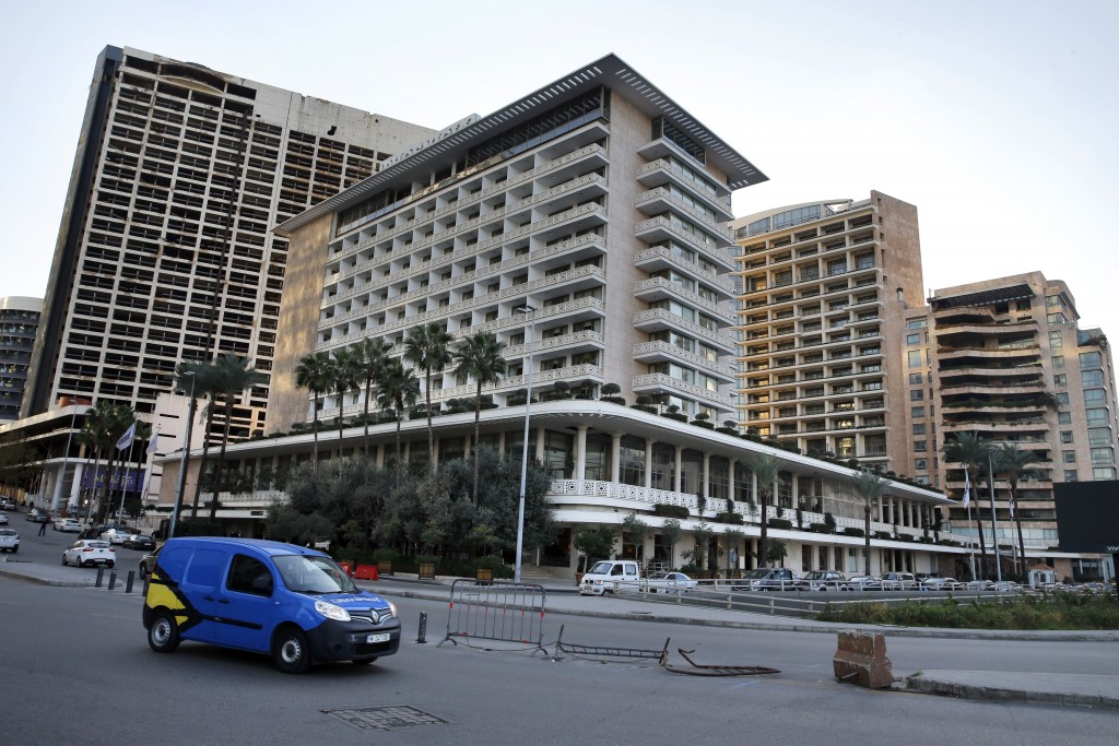 This Wednesday, Dec. 18, 2019 photo, cars passing in front of the Phoenicia Hotel, in Beirut, Lebanon. Lebanon's unprecedented economic crisis and two...