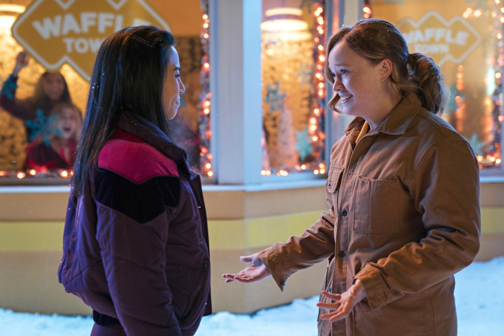 "In this image released by Netflix, Anna Akana, left, and Liv Hewson appear in the holiday movie, ""Let It Snow."" With the yuletide season in full swing..."