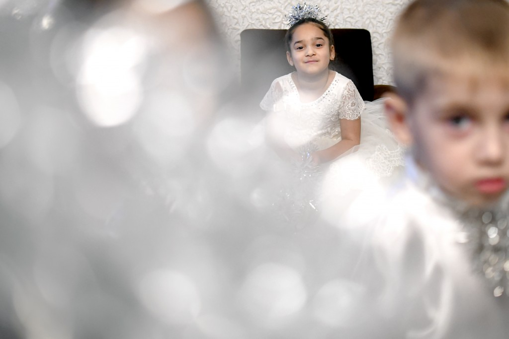 Children prepare to perform in a Christmas show for children in care, in Bucharest, Romania, Wednesday, Dec. 18, 2019. Romania has more than 50 thousa...