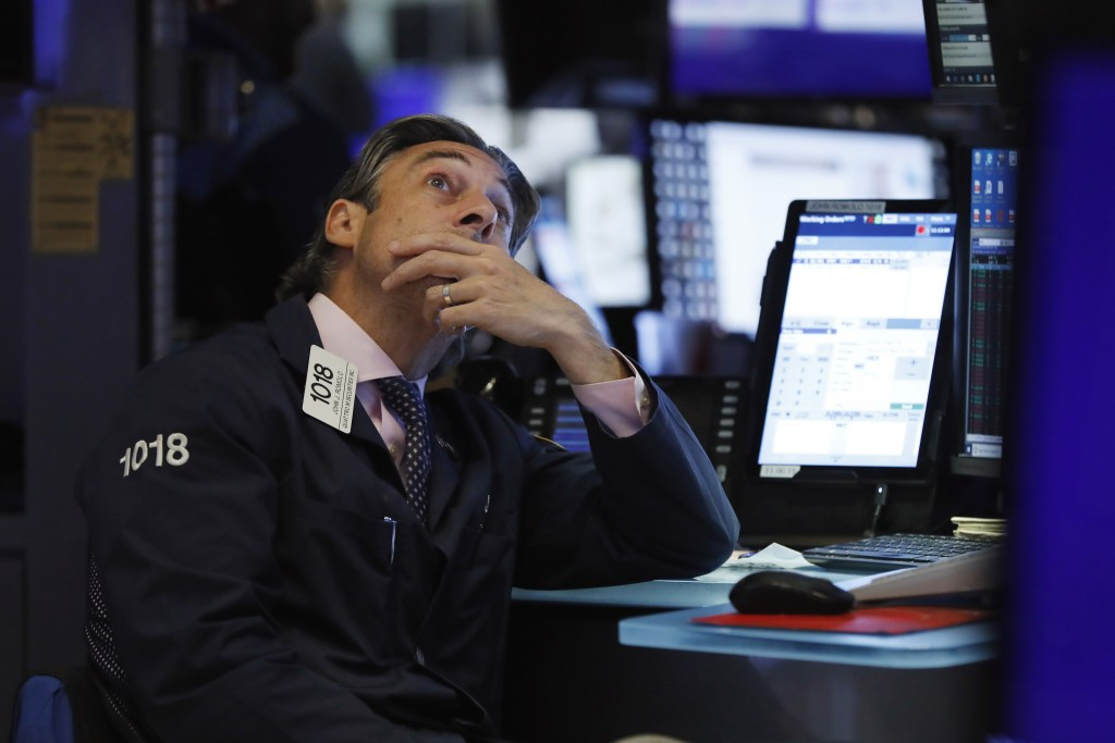 FILE - In this Aug. 7, 2019, file photo trader John Romolo works on the floor of the New York Stock Exchange. Markets are coming off a fabulous 2019, ...