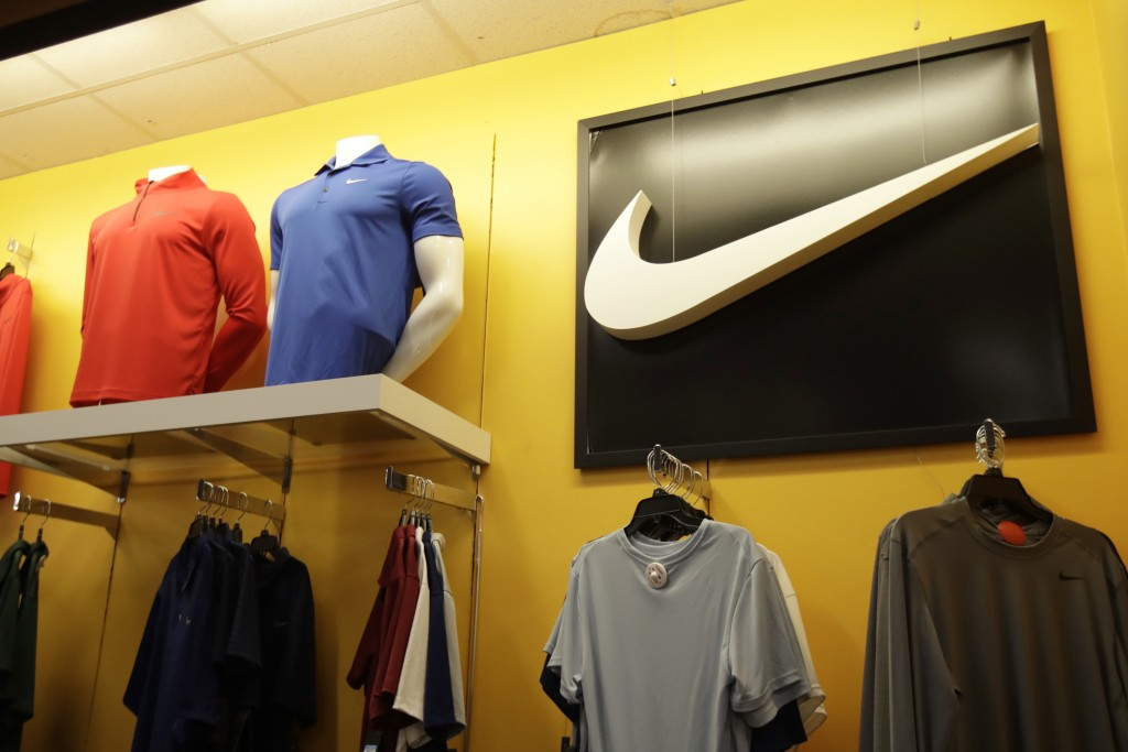FILE - In this Nov. 29, 2019, file photo Nike clothes are displayed at a Kohl's store in Colma, Calif. Nike Inc. reports earnings on Thursday, Dec. 19...