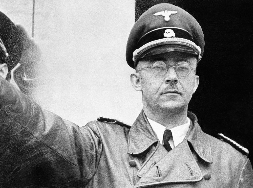 FILE - The undated file photo shows German Nazi party official and head of the SS, Heinrich Himmler. at unknown location in Germany. (AP Photo/str/fil...
