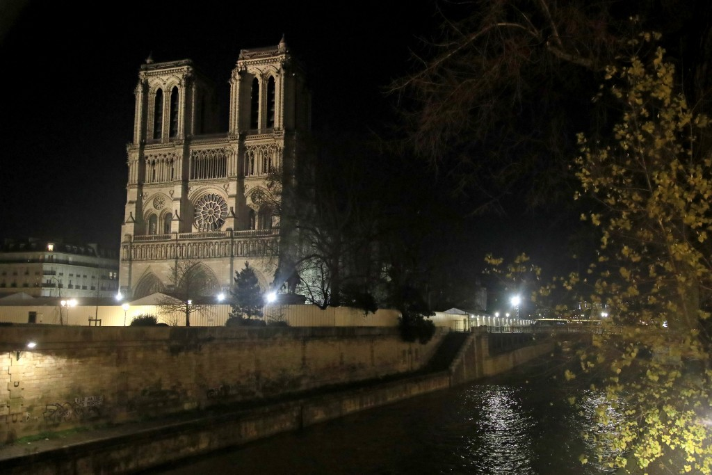 This photo taken on Monday Dec. 16, 2019 shows Notre Dame Cathedral lit up at night, in Paris. Notre Dame Cathedral kept holding services during two w...