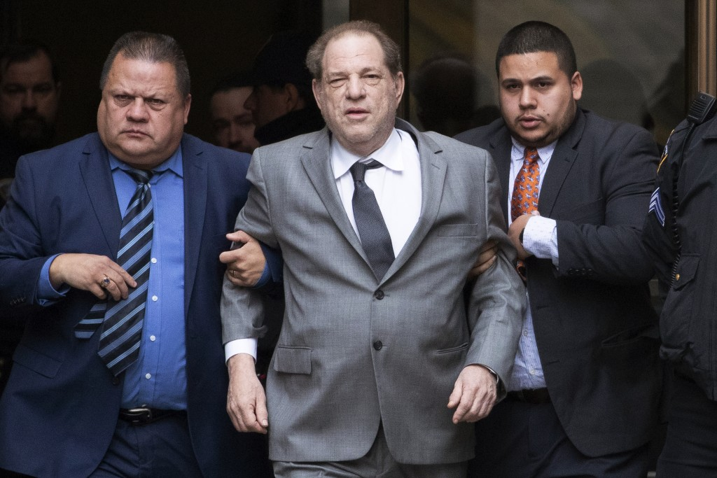 FILE - This Dec. 6, 2019 file photo shows Harvey Weinstein, center, leaving court following a bail hearing in New York. A former model who accused Wei...