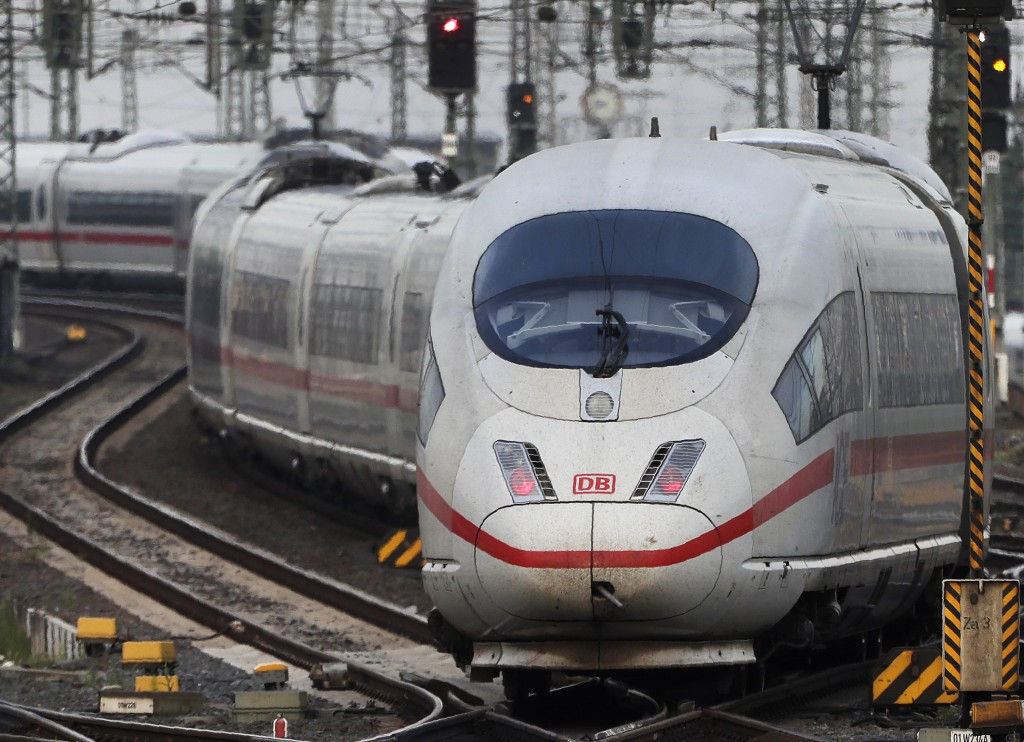 FILE - In this Wednesday, June 19, 2019 file photo, an ICE train approaches the main train station in Frankfurt, Germany. Germany's upper house of par...