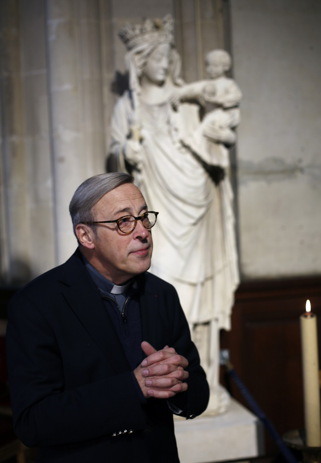 In this photo taken on Tuesday Dec. 3, 2019, Notre Dame cathedral rector Patrick Chauvet talks to the Associated Press, in Saint-Germain l'Auxerrois c...
