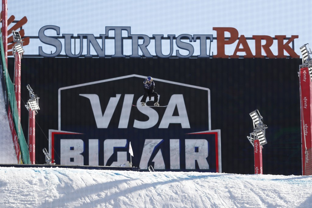 A snowboarder practices for the Big Air Atlanta snowboard and ski competition at SunTrust Park Thursday, Dec. 19, 2019, in Atlanta. (AP Photo/John Baz...