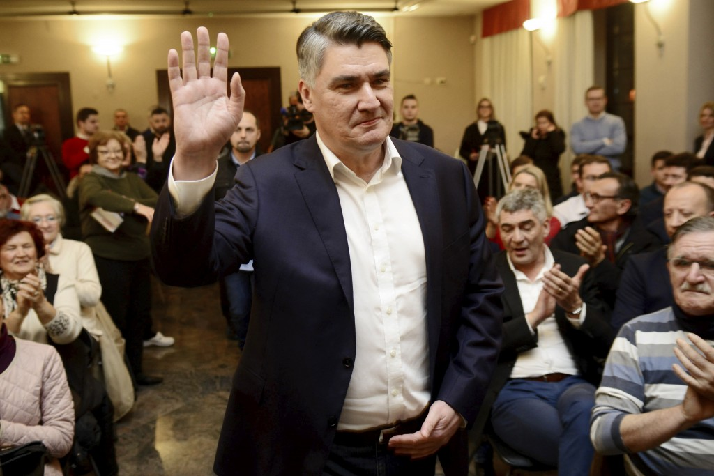 In this Thursday, Dec. 19, 2019 photo presidential candidate Zoran Milanovic greets supporters during a rally in Pula, Croatia. The European Union's n...