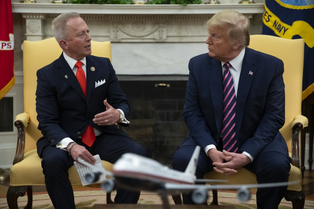 President Donald Trump meets with Rep. Jeff Van Drew, D-N.J., who is planning to switch his party affiliation, in the Oval Office of the White House, ...