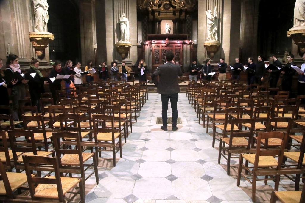 In this photo taken Monday, Dec. 16, 2019, Notre Dame cathedral choir's director Henri Chalet directs the Notre Dame choir during a rehearsal at the S...