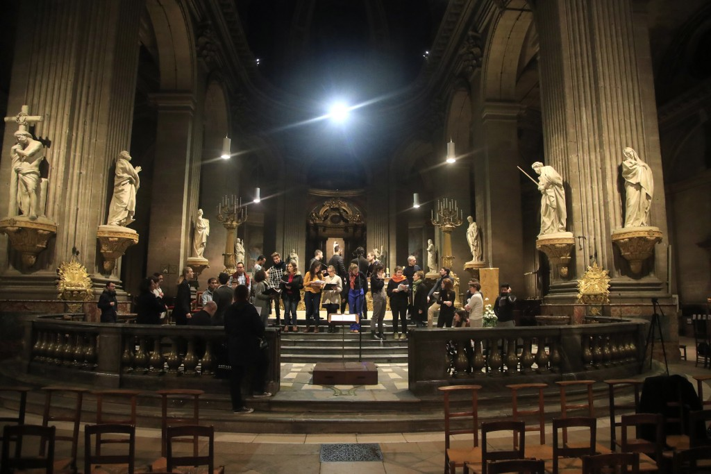 In this photo taken Monday, Dec. 16, 2019, members of the Notre Dame cathedral choir rehearse at the Saint Sulpice church in Paris. Notre Dame Cathedr...