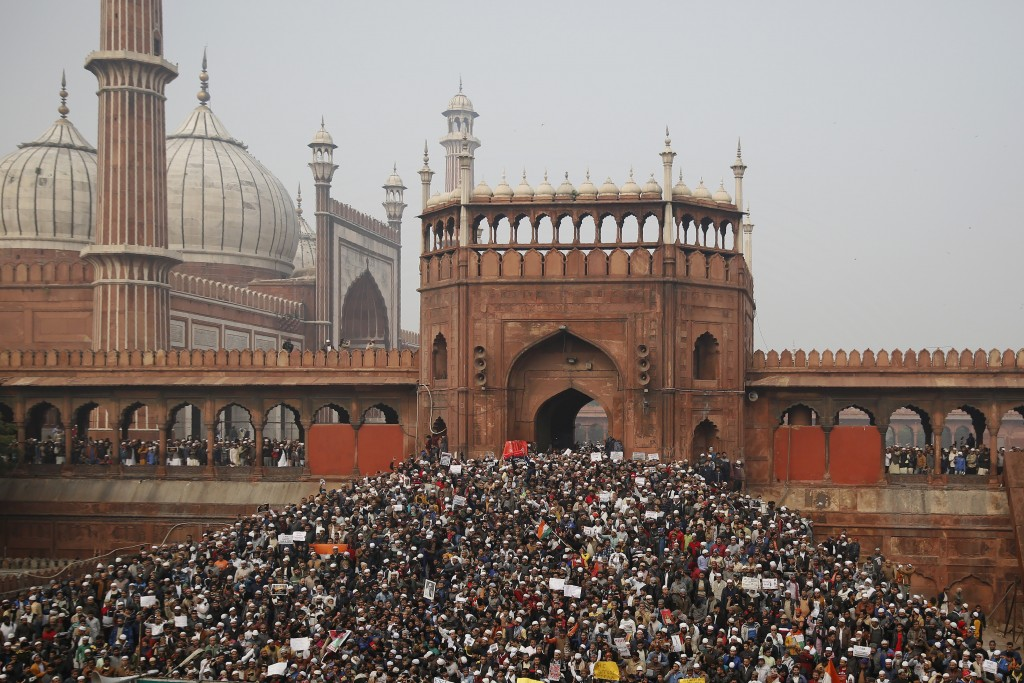 Indians gather for a protest against the Citizenship Amendment Act after Friday prayers outside Jama Masjid in New Delhi, India, Friday, Dec. 20, 2019...