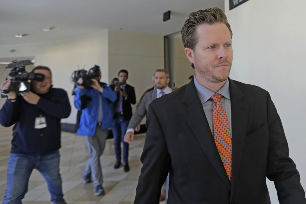 File - In this Nov. 15, 2019, file photo, Paul Petersen, an Arizona elected official accused of running a multi-state adoption scheme, leaves court fo...