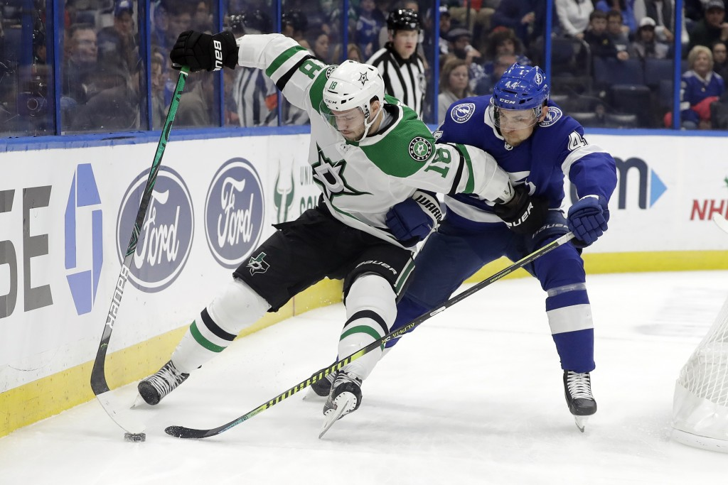 Dallas Stars center Jason Dickinson (18) gets around Tampa Bay Lightning defenseman Jan Rutta (44) during the first period of an NHL hockey game Thurs...
