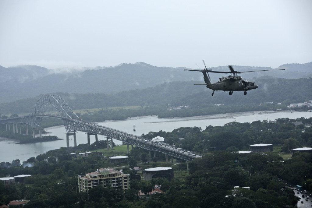 In this Dec. 6, 2019 photo, a U.S. military Black Hawk helicopter flies over the Pacific side of the Panama Canal as it travels to the Darien province...