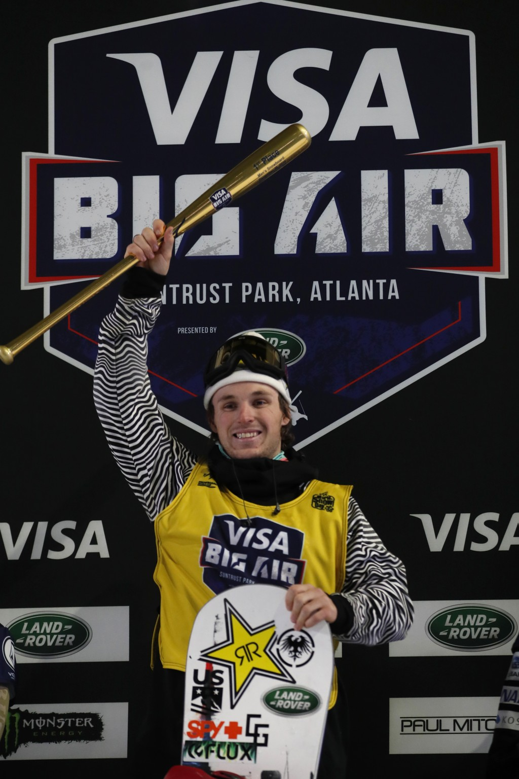 Chris Corning stands on the podium after winning the Big Atlanta snowboard event Friday, Dec. 20, 2019, in Atlanta. (AP Photo/John Bazemore)