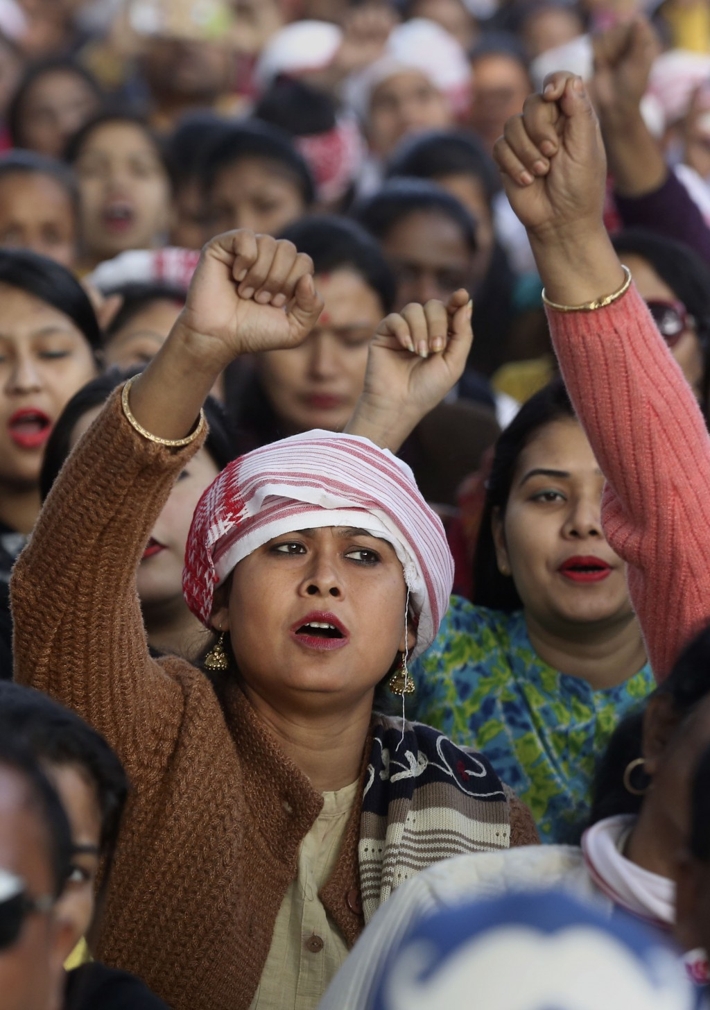 Indians shout slogans during a protest against the Citizenship Amendment Act in Nalbari, India, Friday, Dec. 20, 2019. Police banned public gatherings...