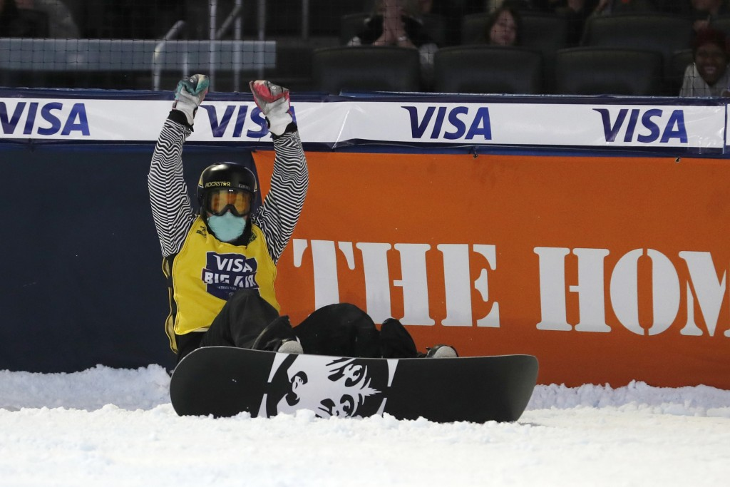 Chris Corning reacts after his final jump in the finals of the Big Atlanta snowboard competition Friday, Dec. 20, 2019, in Atlanta. Corning won the ev...