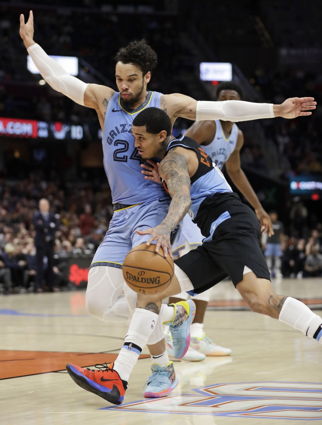 Cleveland Cavaliers' Jordan Clarkson, front right, drives past Memphis Grizzlies' Dillon Brooks (24) in the second half of an NBA basketball game, Fri...