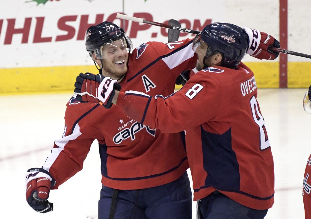 Washington Capitals defenseman John Carlson (74) celebrates his goal with left wing Alex Ovechkin (8) during the third period of an NHL hockey game ag...