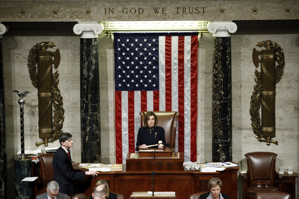 House Speaker Nancy Pelosi, D-Calif., holds the gavel as House members vote on article II of impeachment against President Donald Trump, Wednesday, De...