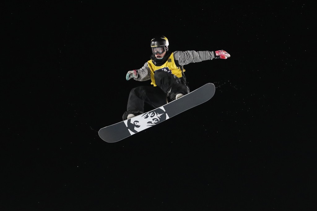 Chris Corning jumps during the finals of the Big Atlanta snowboard event Friday, Dec. 20, 2019, in Atlanta. Corning won the event. (AP Photo/John Baze...