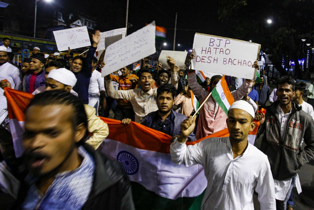 Indians shout slogans during a protest against the Citizenship Amendment Act after Friday prayers outside a mosque in Kolkata, India, Friday, Dec. 20,...