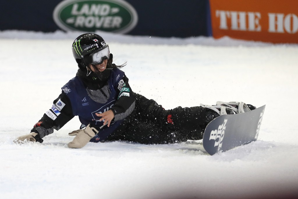 Kokomo Murase, of Japan, falls after crashing on the final jump during the finals of the Big Atlanta snowboard competition Friday, Dec. 20, 2019, in A...