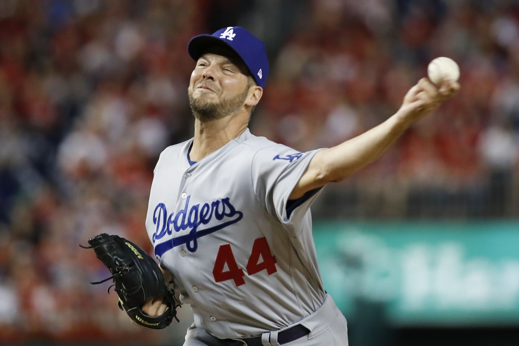 FILE - In this Oct. 7, 2019, file photo, Los Angeles Dodgers starting pitcher Rich Hill throws against the Washington Nationals during the first innin...
