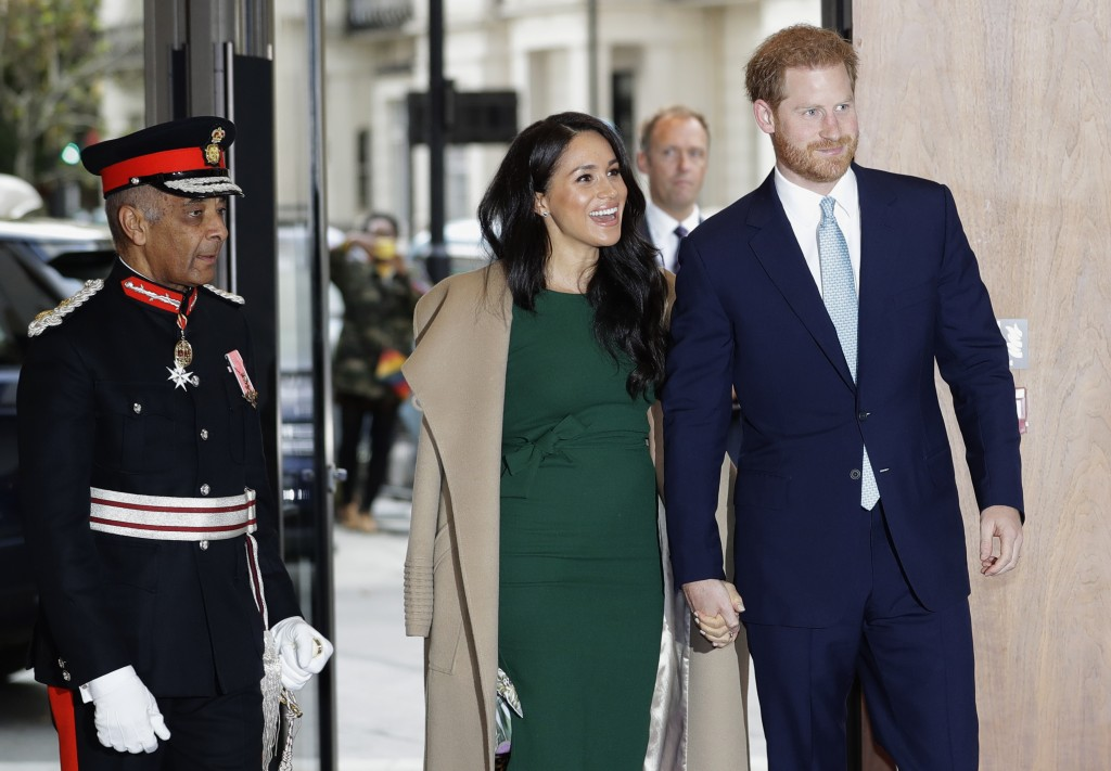 FILE - In this Tuesday, Oct. 15, 2019 file photo, Britain's Prince Harry and Meghan, Duchess of Sussex arrive to attend the WellChild Awards Ceremony ...