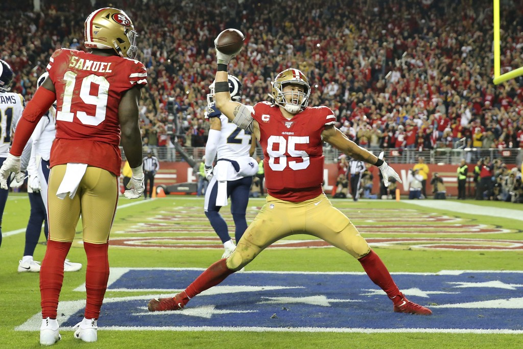 San Francisco 49ers tight end George Kittle (85) celebrates after scoring against the Los Angeles Rams during the second half of an NFL football game ...