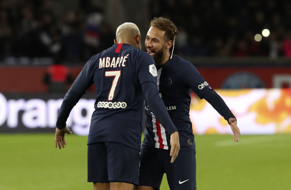 PSG's Kylian Mbappe, left, and Neymar react during the League One soccer match between Paris Saint Germain and Amiens, at the Parc des Princes stadium...
