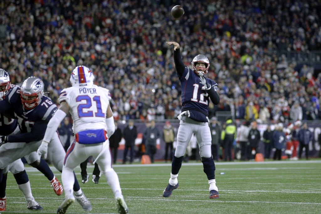 New England Patriots quarterback Tom Brady throws a touchdown pass to tight end Matt LaCosse in the first half of an NFL football game against the Buf...