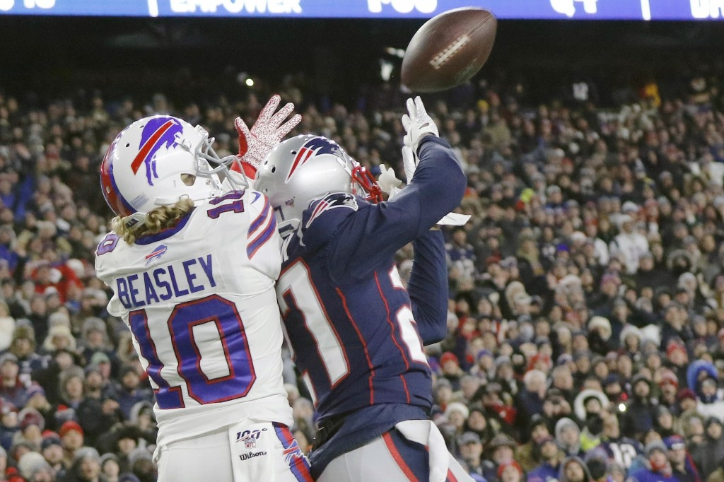 New England Patriots defensive back J.C. Jackson, right, breaks up a pass in the end zone intended for Buffalo Bills wide receiver Cole Beasley in the...