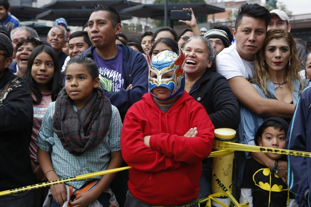 "A crowd watches a ""lucha libre"" fight in Mexico City, Saturday, Dec. 21, 2019. Mexican wrestling, otherwise known as the ""lucha libre,""  is a highly t..."