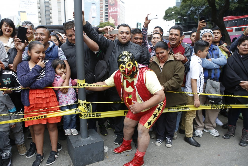 "Mexican wrestler Pinochito poses with the crowd during a ""lucha libre"" fight in Mexico City, Saturday, Dec. 21, 2019. Mexican wrestling, otherwise kno..."