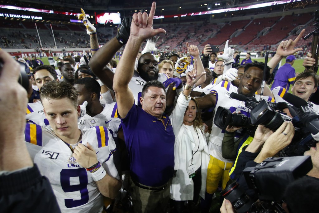 FILE - In this Nov. 9, 2019, file photo, LSU head coach Ed Orgeron celebrates with his players after defeating Alabama 46-41 in an NCAA college footba...