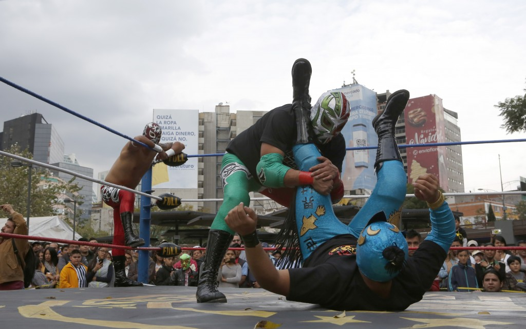 "Mexican wrestler Rakner clashes with Relampago Veloz during ""lucha libre"" fight in Mexico City, Saturday, Dec. 21, 2019. Mexican wrestling, otherwise ..."