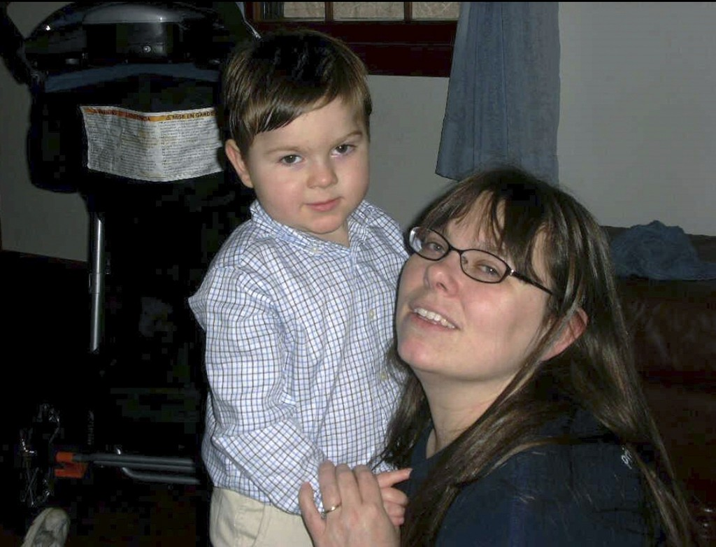 This undated photo provided by Regan Lamphier shows Lamphier, of Nashua, N.H., with her late son Ethan, who died when he was eight. Unlike workers cov...
