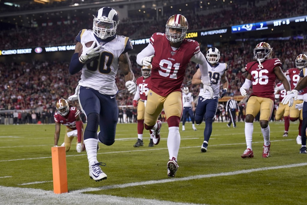 Los Angeles Rams running back Todd Gurley II (30) runs for a touchdown against the San Francisco 49ers during the first half of an NFL football game i...