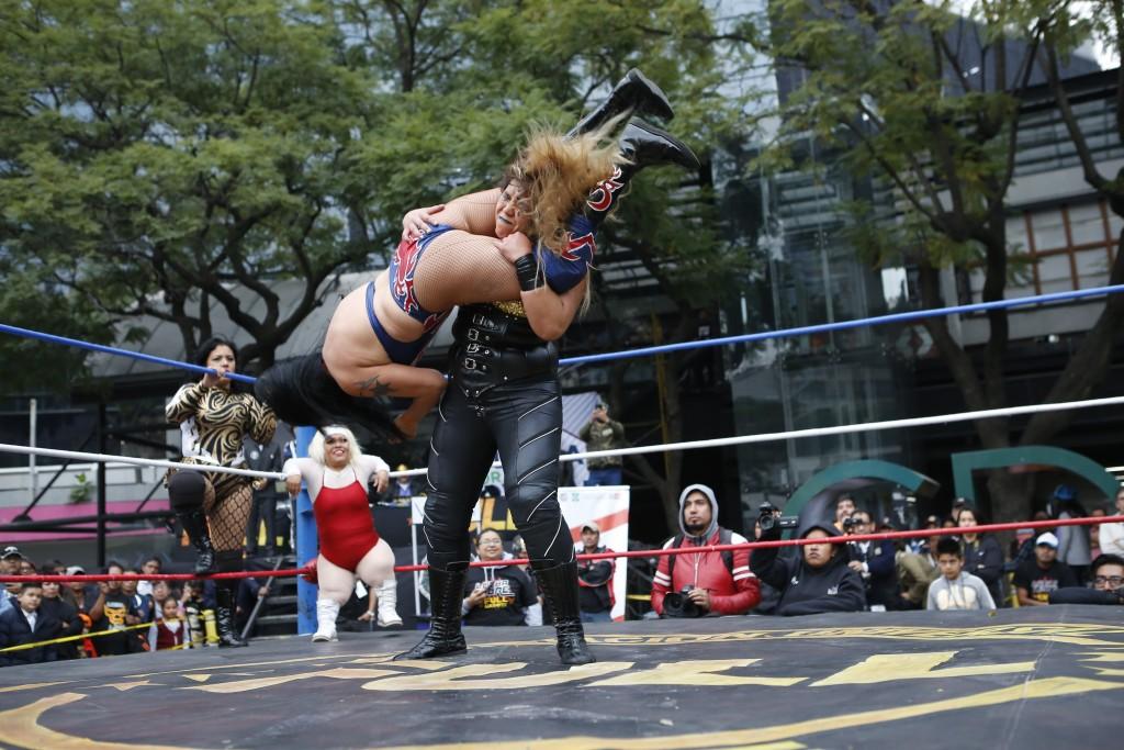 """Mexican female wrestlers Amazona and Brillo de Luna clash during a """"lucha libre"""" public fight in Mexico City, Saturday, Dec. 21, 2019. Mexican wrestli..."""