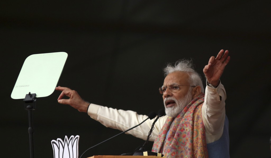 Indian Prime Minister Narendra Modi addresses a rally of his Hindu nationalist Bharatiya Janata Party in New Delhi, India, Sunday, Dec. 22, 2019. Clas...