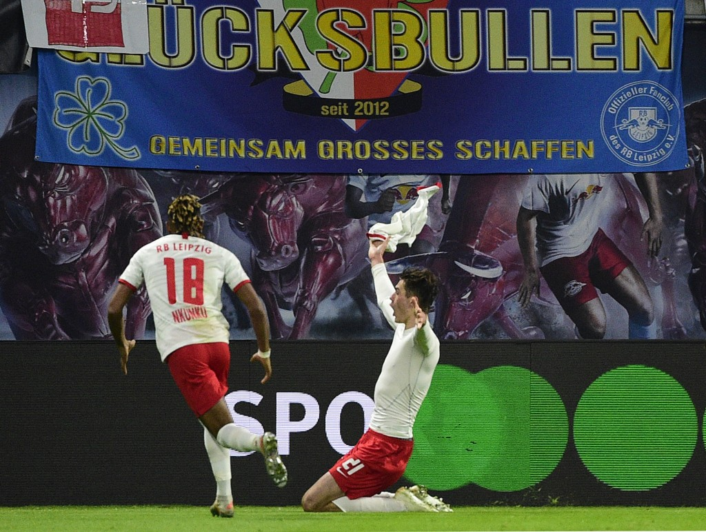 Leipzig's Patrik Schick, right, celebrates after scoring a goal during the German Bundesliga soccer match between RB Leipzig and FC Augsburg in Leipzi...