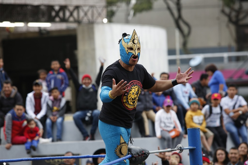 "Mexican wrestler Relampago Veloz encourages the crowd during a ""lucha libre"" fight in Mexico City, Saturday, Dec. 21, 2019. Mexican wrestling, otherwi..."