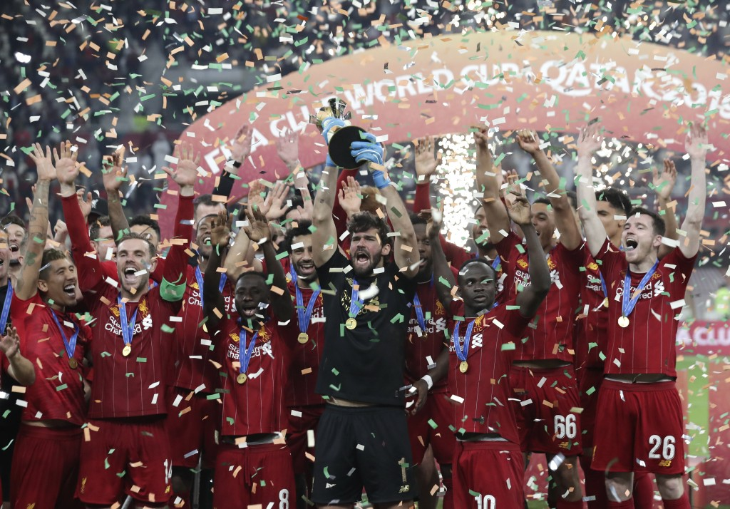 Players of Liverpool celebrate after winning the Club World Cup final soccer match between Liverpool and Flamengo at Khalifa International Stadium in ...
